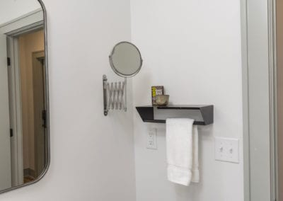 Wall mount extendable mirror, shelf and towel rack.