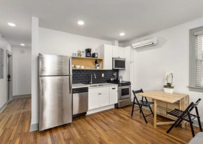 Kitchen with stainless stell appliances and hardwood floors.