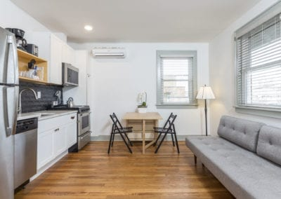 Hardwood floors studio unit. Couch, Dining, Kitchen.