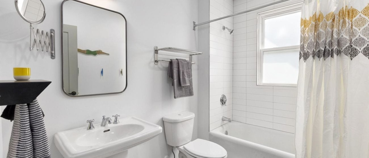 Bright bathroom with tub-shower unit
